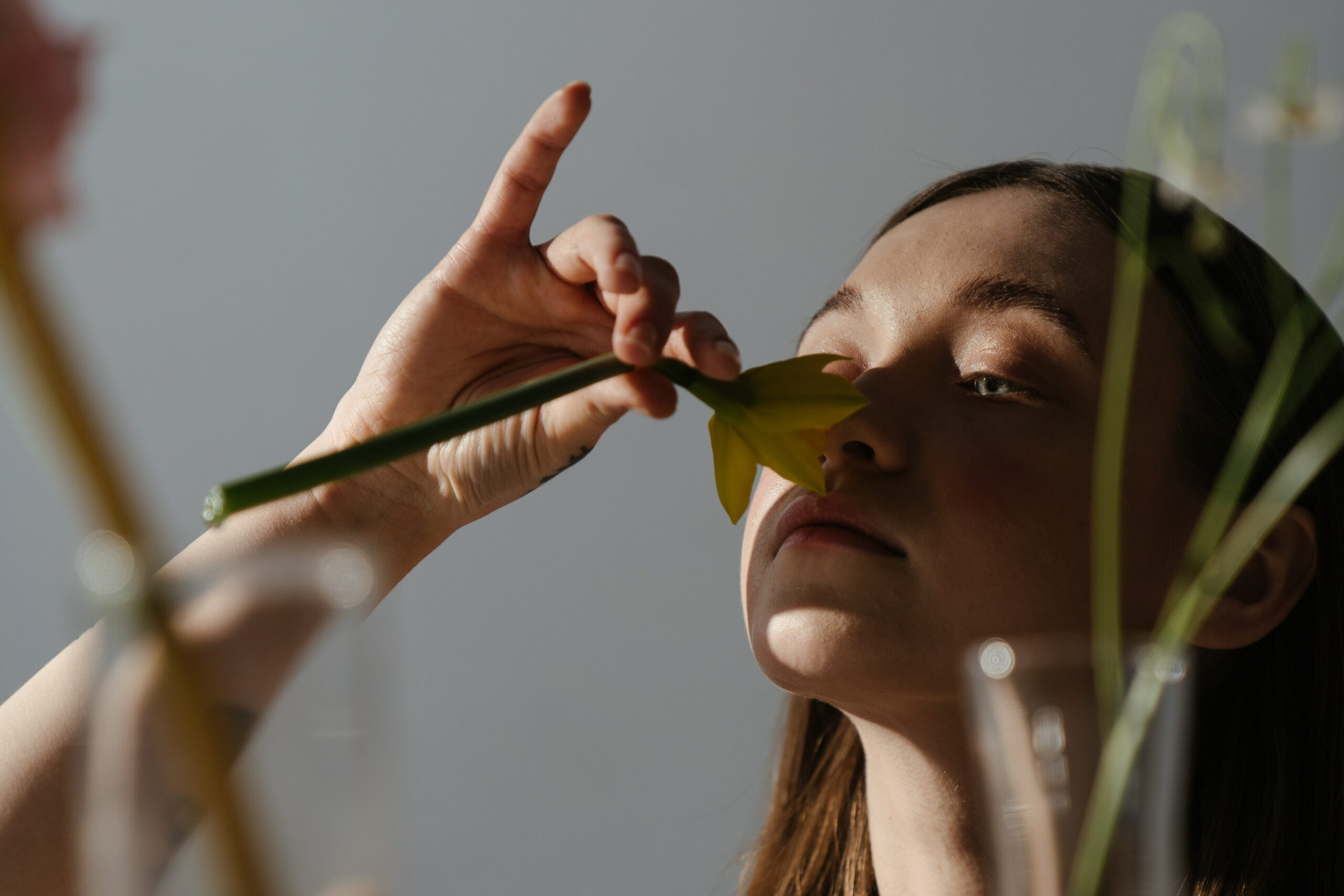 woman-holding-while-smelling-yellow-and-green-flower-4273079 (1)